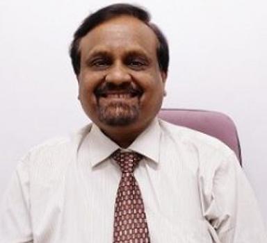 Dr. Anil Karadkar